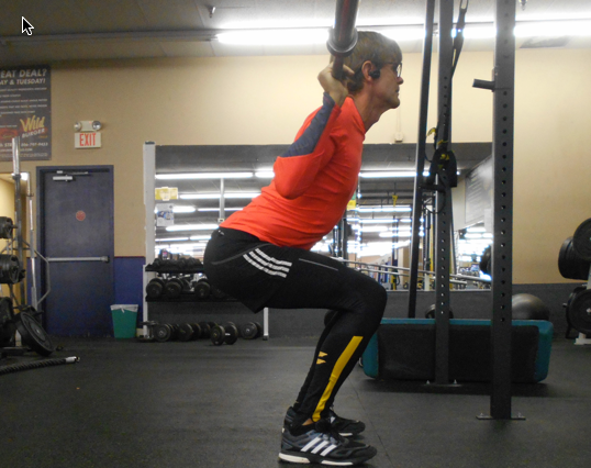 Hips back first, then shins and spine parallel at lowest point