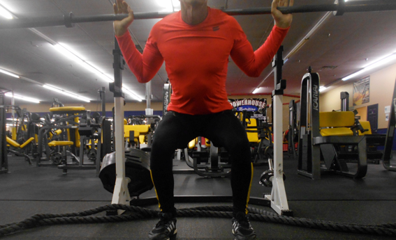 Keep shins vertical and knees at same distance apart throughout movement
